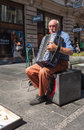 Old man playing accordion belgrade serbia aug on the street on august in belgrade serbia city is famous for having festival of Royalty Free Stock Image