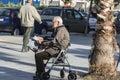 Old man reading a newspaper barcelona spain december sitting in walker in square in barcelona spain on december Stock Photos