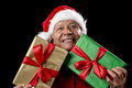 Old Man In Red Gaping Across Two Wrapped Gifts Royalty Free Stock Photo