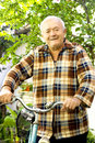 Old man riding bicycle Royalty Free Stock Photo
