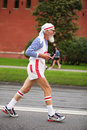 Old man runs on Kremlin embankment Stock Image
