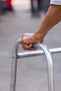 Old man s hand closeup of an using walking frame Stock Photo