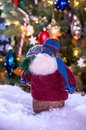 Old man santa on skis holds a bag of toys and a tiny tree Royalty Free Stock Photo