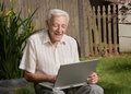 Old man senior working on computer Royalty Free Stock Photos