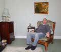 Old man sitting in his armchair senior a care home Royalty Free Stock Photo