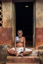 An old man sitting on the steps of his house gokarna india february in gokarna india february Stock Photos