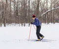 Old man skiing in cross country winter snow ufa russia nd february an exercises to improve his health by a public park ufa russia Stock Photos