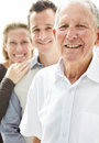 Old man smiling with his son and daughter Stock Photo
