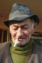 Old man smoking Royalty Free Stock Photo