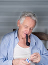 Old man smoking pipe Royalty Free Stock Photo