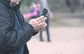 Old man smoking and use his phone Royalty Free Stock Photo