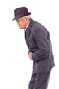 Old man with stomach pain against white background Royalty Free Stock Photography