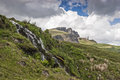 Old man of storr rock formation with waterfall in foreground Stock Photo
