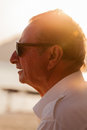 Old man in the sunset portrait shot of an on beach looking at Royalty Free Stock Photography
