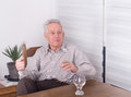 Old man talking moving hands while at dining table Royalty Free Stock Photo