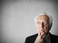 Old man thinking portrait of an seriuos Royalty Free Stock Images