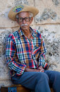 Old man in typical clothes in Havana Stock Images