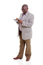 Old man using tablet modern african american computer on white background Stock Photo