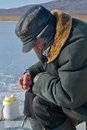 Old man on winter fishing 7 Royalty Free Stock Image