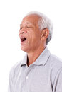 Old man yawning white isolated background Stock Photos