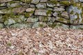 An old manmade stone wall with moss on it Royalty Free Stock Photo