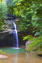 Old mans cave ohio state park waterfall and green trees Royalty Free Stock Photography