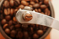 Old manual coffee grinder close up beans in Royalty Free Stock Photo