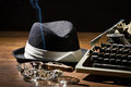 Old manual typewriter cigar and hat Royalty Free Stock Image