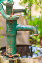 Old manual water pump (Lever pump). Vintage cast iron water pump Royalty Free Stock Photo
