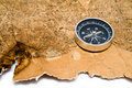 Old map and compass on a white background Royalty Free Stock Photography