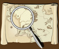Old map with magnifier Royalty Free Stock Photo