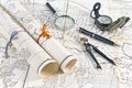 Old Maps in rolls with magnifier and compass Royalty Free Stock Photos