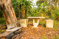 Old marble benches in field Stock Image