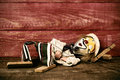 Old marionette on a wooden surface, filtered Royalty Free Stock Photo