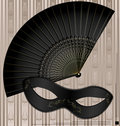 Old mask and fan Stock Images