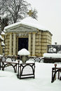 Old mausoleum in winter weathered a cemetery covered snow Stock Photo