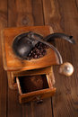 An old mechanical coffee mill whole and ground beans from a hand grinder Stock Photos