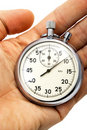 Old mechanical stopwatch lying on hand Stock Image