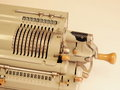 Old mechanical table top calculator with sliders and hand crank many zeros in the display of an melbourne Royalty Free Stock Photo