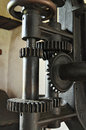Old mechanism metal gears of a machine industrial cogwheel detail Royalty Free Stock Image
