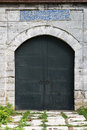 Old Medieval Castle Stone Gate with Iron Door Royalty Free Stock Photo