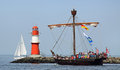 Old medieval cog built vessel port warnemünde germany august ubena von bremen is passing the light beacon on august in the scope Stock Photography