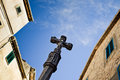 Old medieval jesus on cross statue in the historic village in valldemosa on the island majorca creative editing to give Stock Image