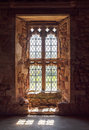 Old medieval window with ancient ruins of brick and stone surrounding arched glass windows with lead piping ornate and decorative Royalty Free Stock Photo