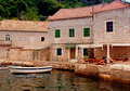 Old mediterranean houses with pier(Montenegro) Stock Photos