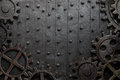Old metal background with rusty gears and cogs Royalty Free Stock Photo