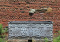 Old metal box in front of weathered brick wall Royalty Free Stock Photo