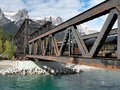 Old metal bridge in canadian rockies railroad spans the bow river canmore alberta canada taken after st snow of season Stock Photo