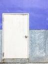 Old metal door behind the warehouse. Royalty Free Stock Photo