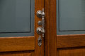 The old, metal doorhandle of a wooden door Royalty Free Stock Photo